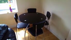 Round glass table hardly used.
