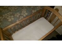 wooden rocking crib and mattress