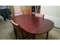 Dark wood oval dining table - extendable. (3 chairs included) VGC £15.00 ono