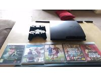 Playstation 3 console with 5 games, 2 controllers, all leads