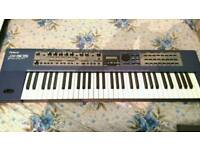 ROLAND JX305 synth in good condition.