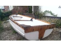 10ft Wood & Fibreglass Boat with Penta 50 outboard, two sets of oars and life jackets.