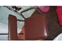 METAL FRAMED PADDED COMMODE CHAIR -STURDY BACKREST AND ARMRESTS