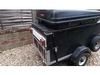 Camping trailer with roofbox