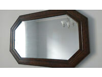 Antique mirror featuring ornate carved frame