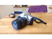 Canon EOS 300 ASLR Camera with bag and manual