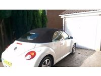 Beige vw beetle. Rare leather, heated seats, convertible