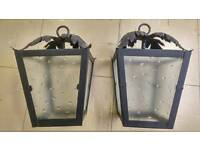 A pair of vintage black cast iron glass panelled lanterns