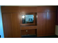 1970s Wardrobes, dressing table and overhead storage units.