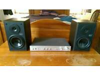 Vintage Rotel stereo integrated amplifier (RA 400) and Denon speakers (USC C35) for sale. Amp.