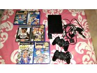 slimline ps2 with 6 games 2 controllers