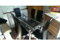 Glass Dining Table with six chairs