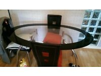GLASS OVAL DINING TABLE AND CHAIRS....FREE TO UPLIFT!!!!