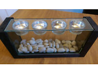 Tea candle holder with glass pebble feature