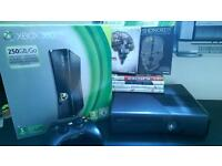Xbox 360 black with box and 6 games for offers