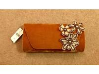 Anthropologie clutch bag with tags