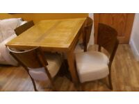 Oak Extendable dining table and Six Leather chairs Priced to Sell