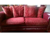 Red leather/chenille 3 seater sofa