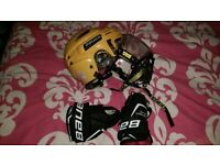 ice hockey bauer helmet with face visor and gloves