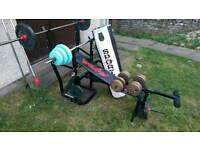Weight bench and bars boxing bag