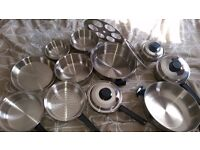 BRAND NEW 11 PIECE STAINLESS STEEL SET OF POTTS ,PANS,FRYERS AND OTHER SMALL POTS