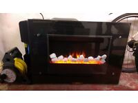 Wall mountable fire place good condition complete with remote control