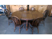 Solid oak extending dining table and 6 chairs in VGC