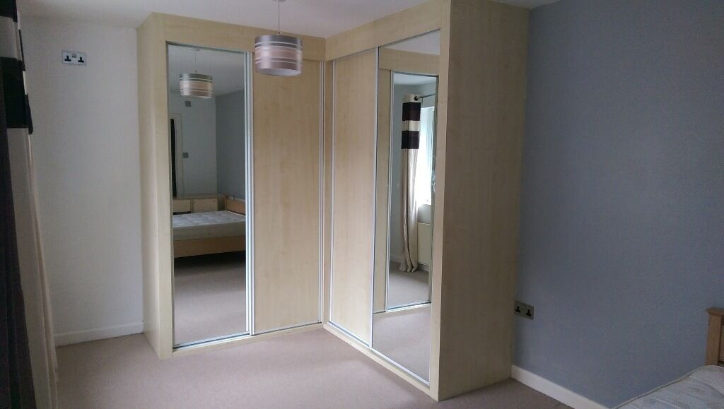 Fitted corner wardrobe with sliding doors in wareham for Sliding glass doors gumtree