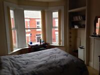 Room with double bed in spacious house