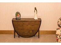 "Ercol Windsor, solid Elm, gate-leg (drop-leaf) coffee table Model 1820 ""Ercol Traditional"" finish"