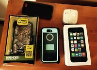 32gb iPhone 5s, two otter box defender cases