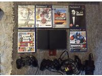 PS2 + Controllers + Games