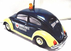 Tin & Plastic Volkswagen AMBULANCE WITH FRICTION & HORN.