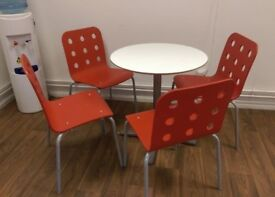 Small table and 4 stackable chairs