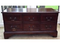Dark Wood TV Cabinet. 2 Drawers. Drop down front providing storage for DVD player.