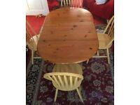 Folding oval table