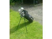 Golf set 2 drivers 2 woods and irons 3-Sand wedge plus bag and balls