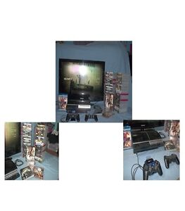 PS3 With 2 Controllers A Movie & 60 Games - Ready To Go Sarnia Sarnia Area image 1