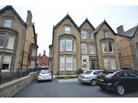 2 bedroomed split level flat with private decked terrace & off-road parking