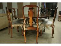 Solid wood oak circular dining table and set of six dining chairs