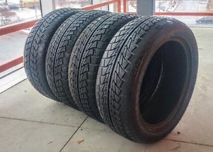 Set of four 215/55/17 Nanking winter tires with 9/32nd tread.