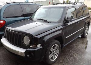 2008 Jeep Patriot Limited 4X4, leather,Nav.,sunroof NEED TRANY.