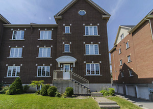 High-end, open-concept, top-level condo in Bois Franc.