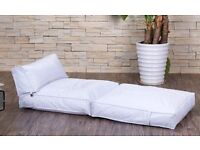 White leatherette beanbag chair/fold out bed for sale