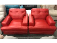2 x DFS Quantum red leather Armchairs