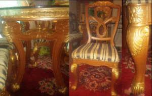 BROWN AND GOLDEN DINING TABLE+HEAVY ROUND TOP GLASS+FOUR CHAIRS