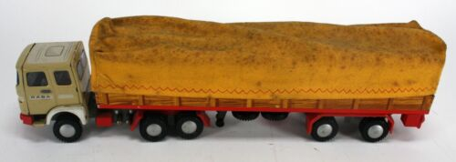 """VINTAGE RABA TIN TOYS TRACTOR TRAILER WITH CLOTH COVER. MADE IN HUNGARY.  14""""."""
