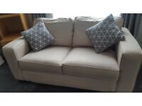 x 2 Seat Settee in Beige, in good condition H 31 ins x D 35 ins x W 66 ins