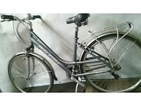 Womans Raleigh Hybrid Step Through Frame Design 700c Wheels includes Extras.