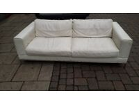 White leather three seater sofa